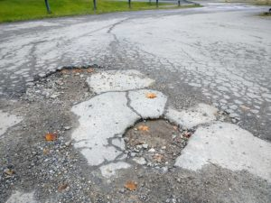 Potholes are a surefire sign you need a driveway replacement