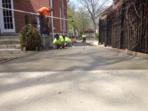 Team installing a concrete driveway
