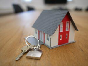 model house next to set of keys