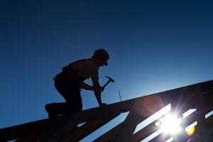 Alpharetta roofing contractor hammering on roof