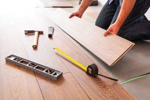 Atlanta flooring contractor installing hardwood floor