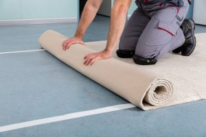 person during carpet installation