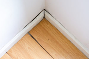 space between baseboard and wall
