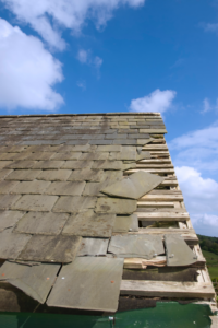 roof damage on edge with missing shingles