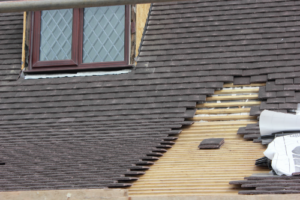 Roof repair in process with missing shingles