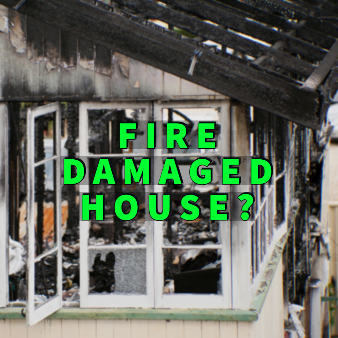Fire Damaged House written over house with fire damage